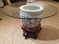 Round glass top ceramic table with wooden leg base