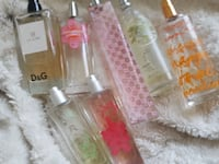 three clear glass bottles with pink plastic lids Brossard