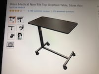 Adjustable brand new,  never used, over bed medical table. Made by Drive, used in most hospitals. Arlington, 22207