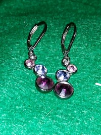 pair of women's silver-colored earrings with purple and pink gemstones