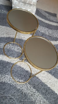 2 gold leaf and mirror side tables