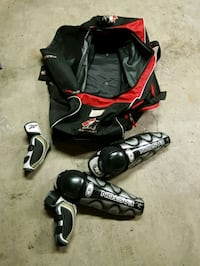 black and red hockey bag, knee/shin and elbow pads Pitt Meadows, V3Y 1B2