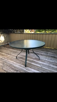 Green legs and glass top patio table North Vancouver, V7L 2J3