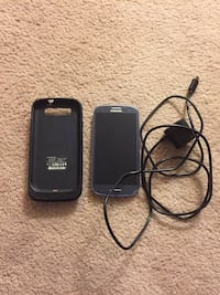 black Samsung Galaxy S3 with charger and charging case 3501 km
