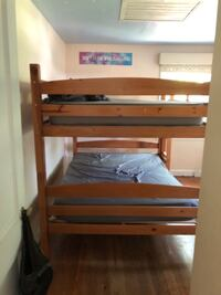 Double wooden bunk beds with mattress pads Silver Spring