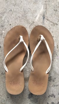 pair of white Rozy t-strap sandals