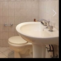 Light beige  ceramic sink with faucet and toilet Toronto, M5R 1J3