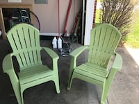 Two green patio chairs