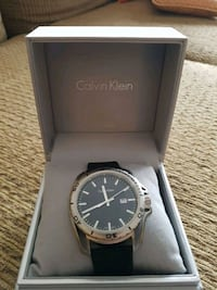 round silver analog watch with black strap in box Pickering, L0H 1H0