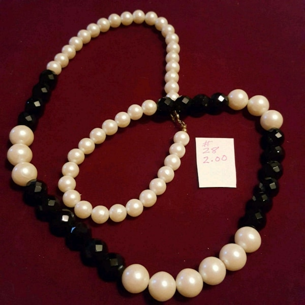 white pearl beaded necklace and bracelet