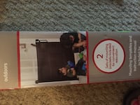 Retractable baby gate. Brand new, never used  Waterloo, N2L 2A1