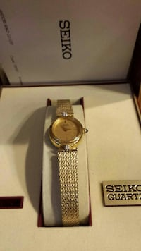 round gold Seiko analog watch with band in box Hebron, 43025