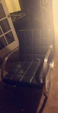 black and gray leather padded chair Las Vegas, 89148