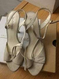 women's black and white Le chateau sandals