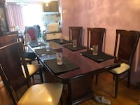 Rectangular wooden table with chairs