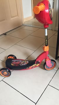 Red and black Lightning McQueen print kick scooter