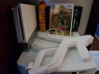 Nintendo Wii console with 2 controllers and games