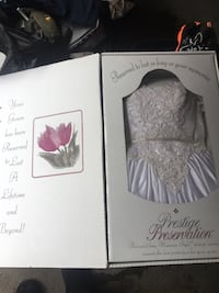 Mori Lee Wedding gown size 5 boxed air tight and preserved contact for more details. Markham, L3P 2T5