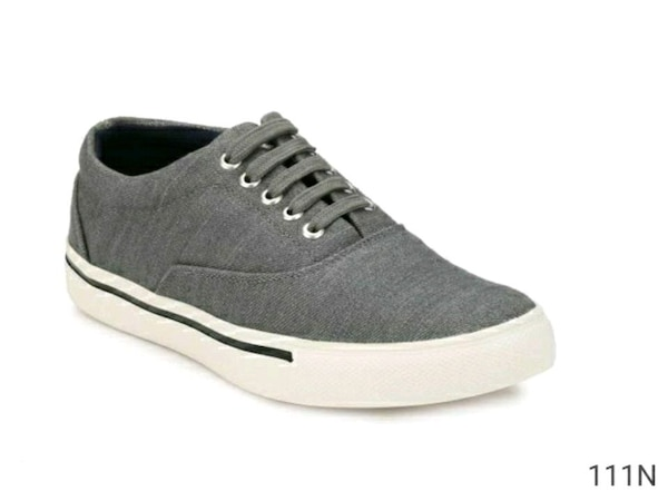 unpaired gray and white low top sneaker