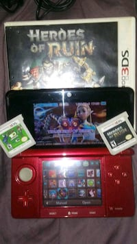 red Nintendo 3DS with game cases Lake Elsinore, 92530