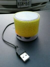 yellow and black portable speaker