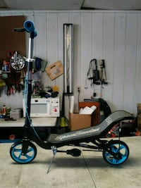 black and gray motorized scooter 1496 mi
