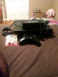 black Xbox 360 console with controller and game cases Lafayette, 70506