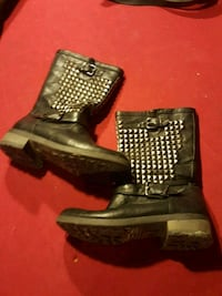 pair of black leather boots Calgary, T2A