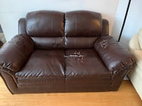 Brown two seater couch