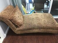brown and black floral fabric sofa