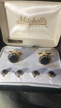 silver-colored and black gemstone rings 326 mi