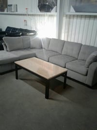 white fabric sectional sofa with ottoman
