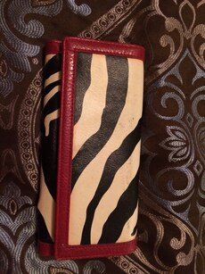 red, black and white leather clutch bag