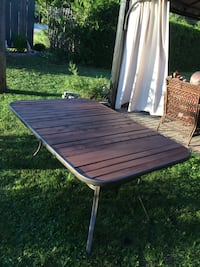 Rustic wooden top patio table