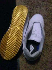 pair of yellow-and-black Nike running shoes Henderson, 80640