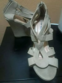 pair of white open-toe ankle strap heels Las Vegas, 89121