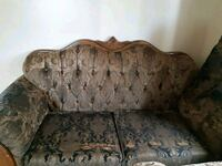 brown and black floral fabric sofa Calgary, T1Y 1P7