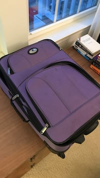 """Used 22"""" x 14"""" x 7"""" carry on purple Suitcase.  Frederick, 21704"""