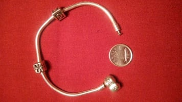 Authentic PANDORA Sterling silver bracelet with 2 charm!