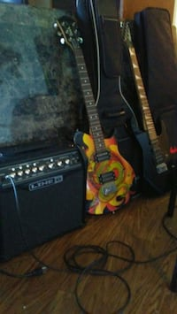 yellow and black electric guitar with guitar amplifier