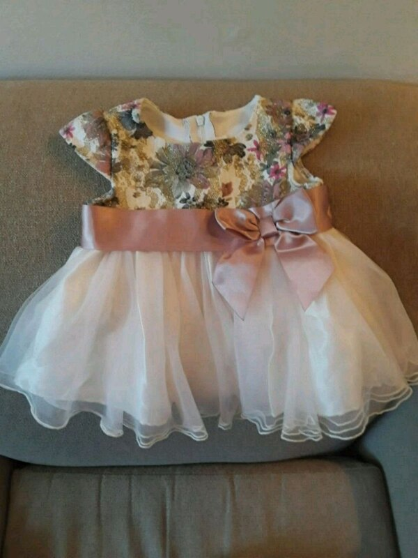 girl's white and pink floral dress