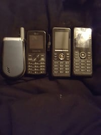 three black candybar phone and gray flip phone Bowie, 20716