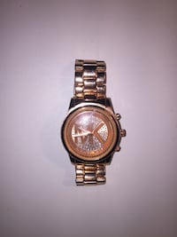 round gold-colored chronograph watch with link bracelet London, N6H 4W1