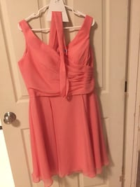 "Angelina faccenda bridesmaid dress in coral. Size 20 BUT altered to fit a size 14-44"" bust. 5'3"". Knee length. Worn once. Dry cleaned since. San Francisco, 94123"
