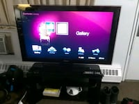 black flat screen TV with remote 2669 km