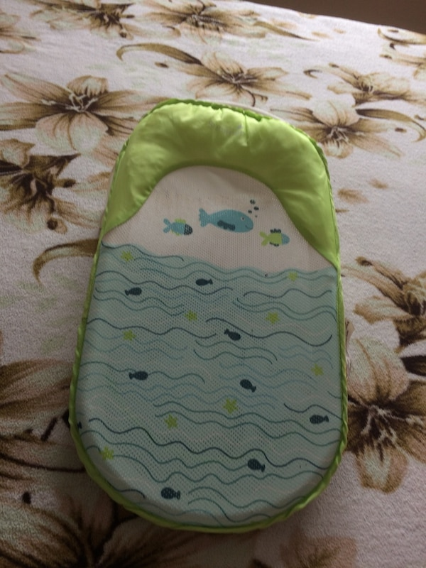baby's green and white bather