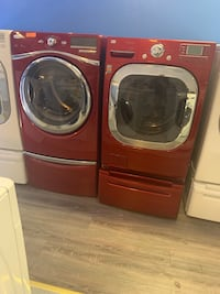 Front load washer and dryer set with pedestal working perfectly  Baltimore, 21223