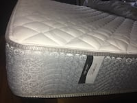 White and gray quilted mattress Medford