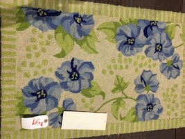 Green and blue floral rug