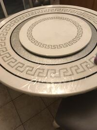 Round white and grey stone table  Whitby, L1P 0A4